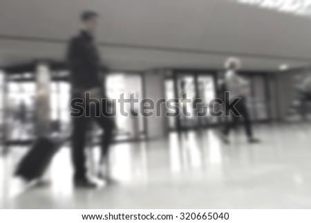 abstract blur of passengers rushing at big city  - stock photo