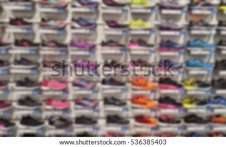 abstract blur of shoes in shop