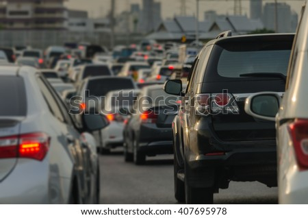 abstract blur of traffic jam with row of cars on expressway during rush hour - stock photo