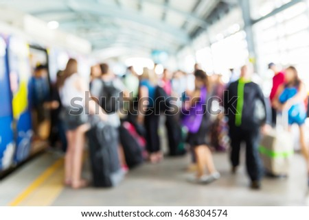 Abstract blur people getting on electric sky train, railroad transportation for passenger in city, urban lifestyle