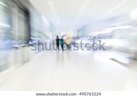 Abstract blur people in beautiful luxury shopping mall center and shop retail store for background