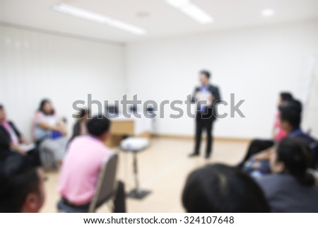 abstract blur people in classroom education concept / Blur people in meeting room / Thai people