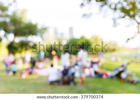 Abstract blur people picnic in public park with family or friends, urban leisure lifestyle - stock photo