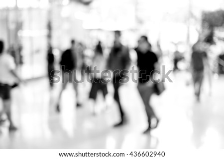 Abstract blur people walking in fashion mall. Black and white filter - stock photo