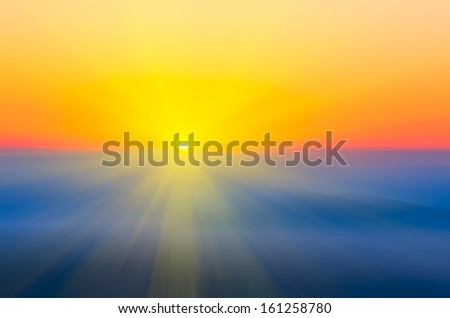 Abstract blur sun rises over the mountains - stock photo