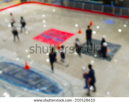 Abstract blur the group children playing ice hockey. - stock photo