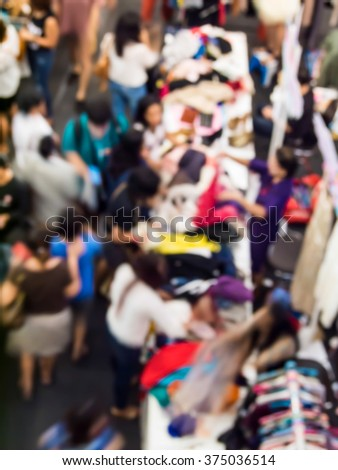 abstract blur the people at the  traditional clothes market.