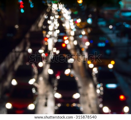 Abstract blur traffic jam city night background. - stock photo