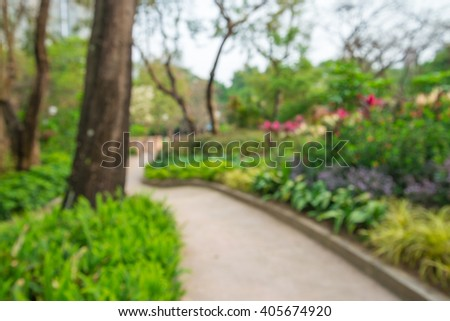 Abstract blur walkway in city park bokeh background - stock photo