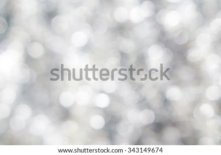 Abstract blured background of tender silver white shiny Christmas tree decorations - stock photo