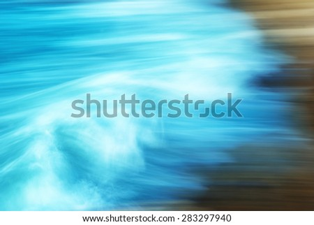 Abstract blured motion- big waves breaking on the shore - stock photo