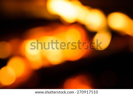 abstract blurred background burning wood in fireplace - stock photo
