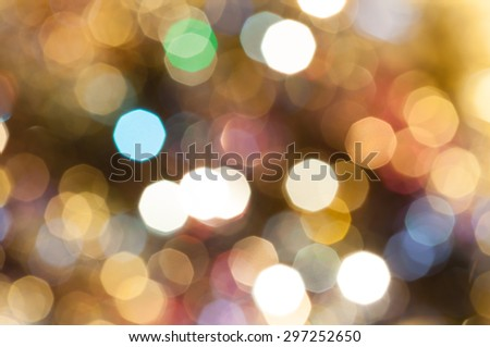 abstract blurred background - colorful brown shimmering Christmas lights bokeh of electric garlands on Xmas tree - stock photo