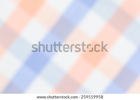 Abstract blurred background from fabric plaid texture. - stock photo