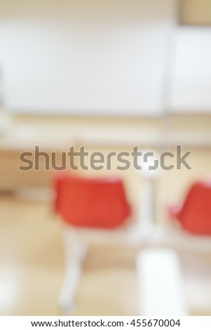 Abstract blurred background image of empty classroom without student after school;Blurry view of exam hall with red lecture chairs in room at the end semester in college or university.Back to school - stock photo