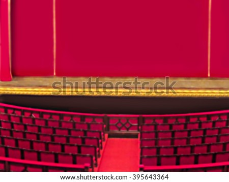 Abstract blurred background image. The interior of the theater arts. The auditorium with seats  - stock photo
