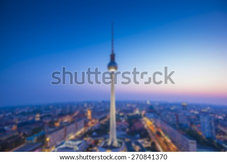 abstract blurred background of Berlin with TV Tower at evening, Germany - stock photo