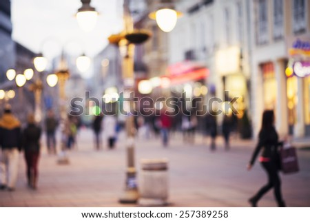 abstract blurred background of people walking in city center - stock photo