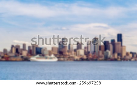 Abstract blurred background of the panoramic view of the Seattle skyline from the boat in the Puget Sound's Elliot Bay.  - stock photo