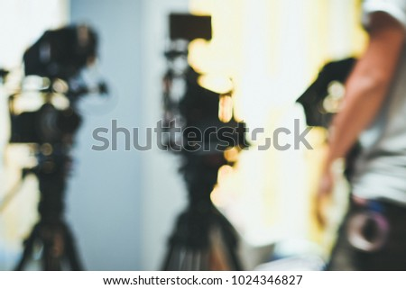 Abstract blurred background of video camera shooting  in studio, recording movie production, behind the scenes