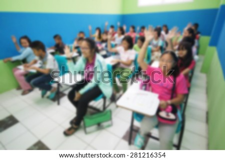 Abstract blurred background of young students studying on weekends in a small class of a tutorial school  - stock photo