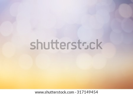 abstract blurred background with circle light.blur ideal image concept:blurry pastel color wallpaper:blur colorful of purple,lavender,mauve,yellow,orange,gold backdrop display:sunset evening hour. - stock photo