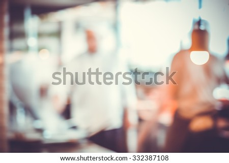 abstract Blurred background with kitchen interior and light bulb - stock photo