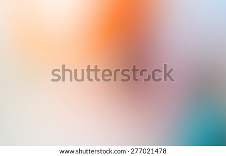 abstract blurred background with orange, blue, beige and gray stains - stock photo