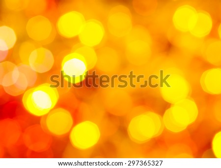 abstract blurred background - yellow and red twinkling Christmas lights of electric garlands on Xmas tree