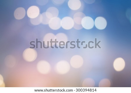 abstract blurred backgrounds of sunset backdrop with circle lights in pastel tone colour.blur of bokeh circle light christmas festive backdrop concept. - stock photo