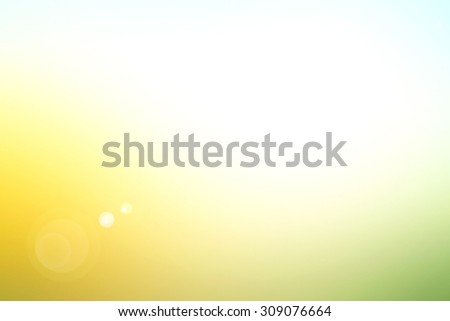 Abstract blurred beautiful sunset background: yellow green and blue patterns. - stock photo
