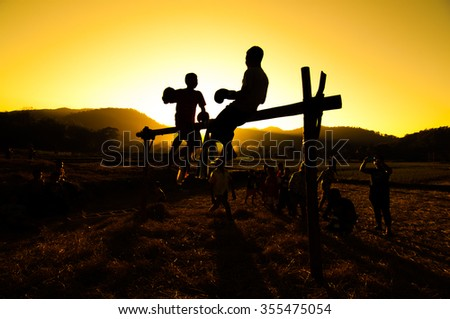 Abstract blurred,blurry,silhouette of thai boxing on the wood.art tone background - stock photo