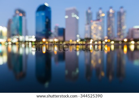 Abstract blurred bokeh background city lights with water reflection at night - stock photo
