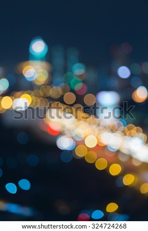 Abstract blurred bokeh city district downtown at night - stock photo