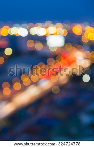 Abstract blurred bokeh city highway light during twilight  - stock photo