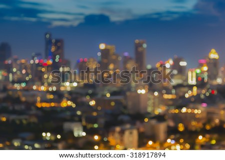 Abstract blurred bokeh light city business area with twilight sky background - stock photo