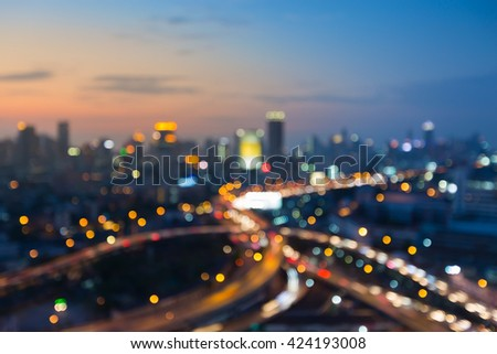 Abstract blurred bokeh lights, city downtown background and highway after sunset - stock photo
