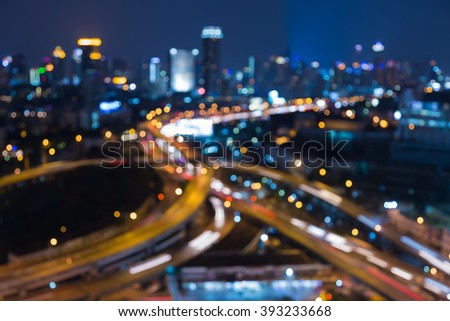 Abstract blurred bokeh lights, city elevated road night view - stock photo