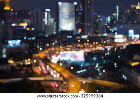 Abstract blurred bokeh lights, city highway intersection at night - stock photo