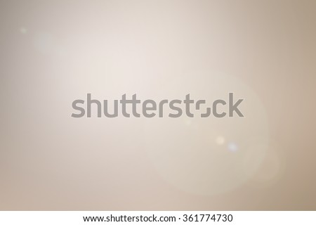 abstract blurred bright cream brown background.blurry light beige tan color tone backdrop with lens flare lights.blur vintage effect wallpaper concept idea:luminous ablaze wall color conceptual. - stock photo