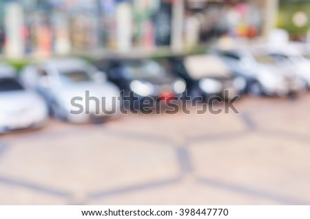 Abstract blurred car in outdoor parking lot - stock photo