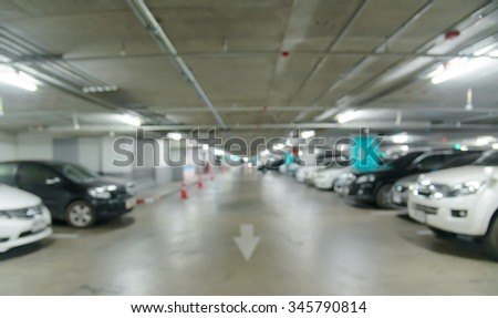 Abstract blurred car in parking background
