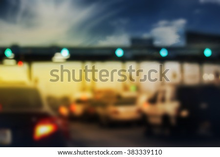 Abstract blurred cars on road street background, movement of vehicles in traffic jam hours, blur working day concept, congest transport, toll station jam. - stock photo