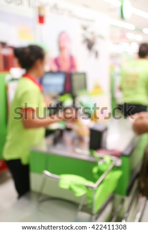 abstract blurred cashier at a supermarket checkout in a department store.