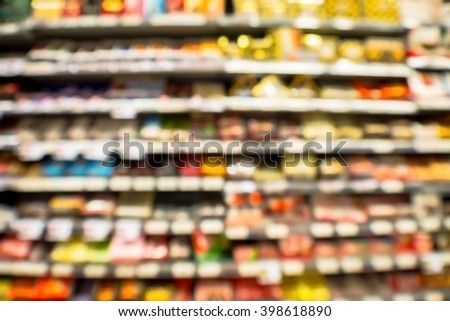 abstract blurred chocolate sweets on supermarket shelf in the mall department store. - stock photo
