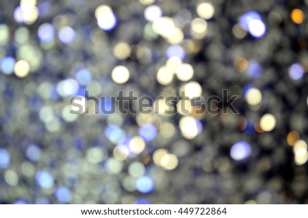 Abstract blurred circular bokeh of blue and silver sequin - stock photo