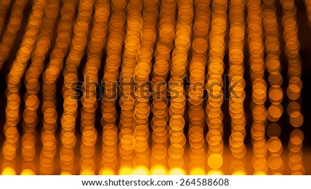 Abstract blurred circular bokeh of golden lights background - stock photo