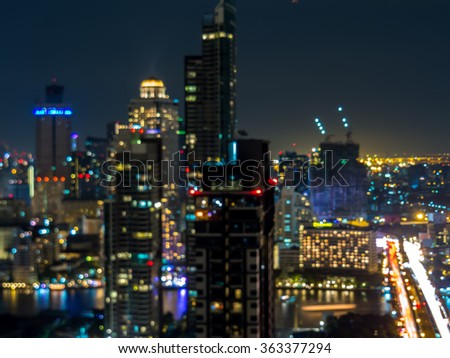 Abstract blurred cityscape of Bangkok city at night - stock photo