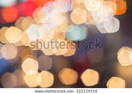 Abstract blurred colorful of traffic circle light backgrounds:blurred night city with colour ploygon bokeh light:blur bokeh light christmas festive backdrop concept:out of focused concept:blur concept - stock photo