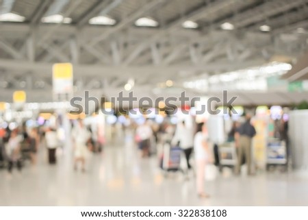 abstract blurred crowd people walking in the airport for check-in flight to travel or making business - stock photo